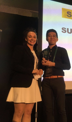 Kenji, from Enactus Manchester who is their team leader collecting the teams award!