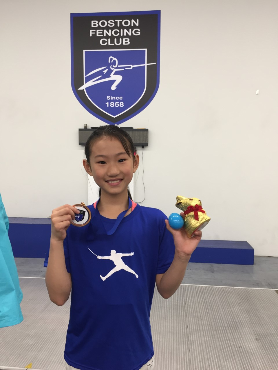 Pictured: Iris Yang wears her Bronze Medal for Y-10 Women's Foil