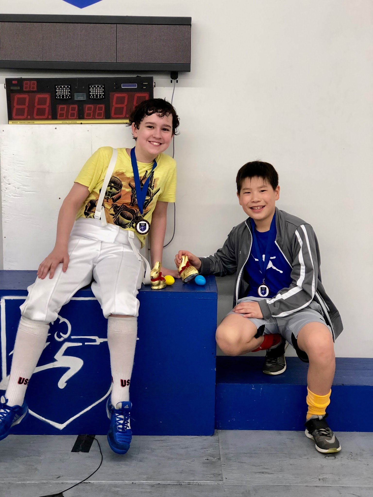 Pictured: Gabriel McCarthy (left) won a Top-8 Medal in Y-12 Men's Saber. Shaun Kim (right) won Bronze Medals in Y-12 and Y-14 Men's Saber
