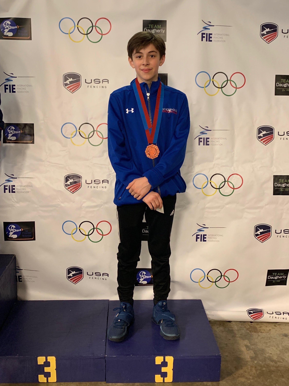 Pictured: Max Denner wins a Bronze Medal in Y-14 Men's Saber