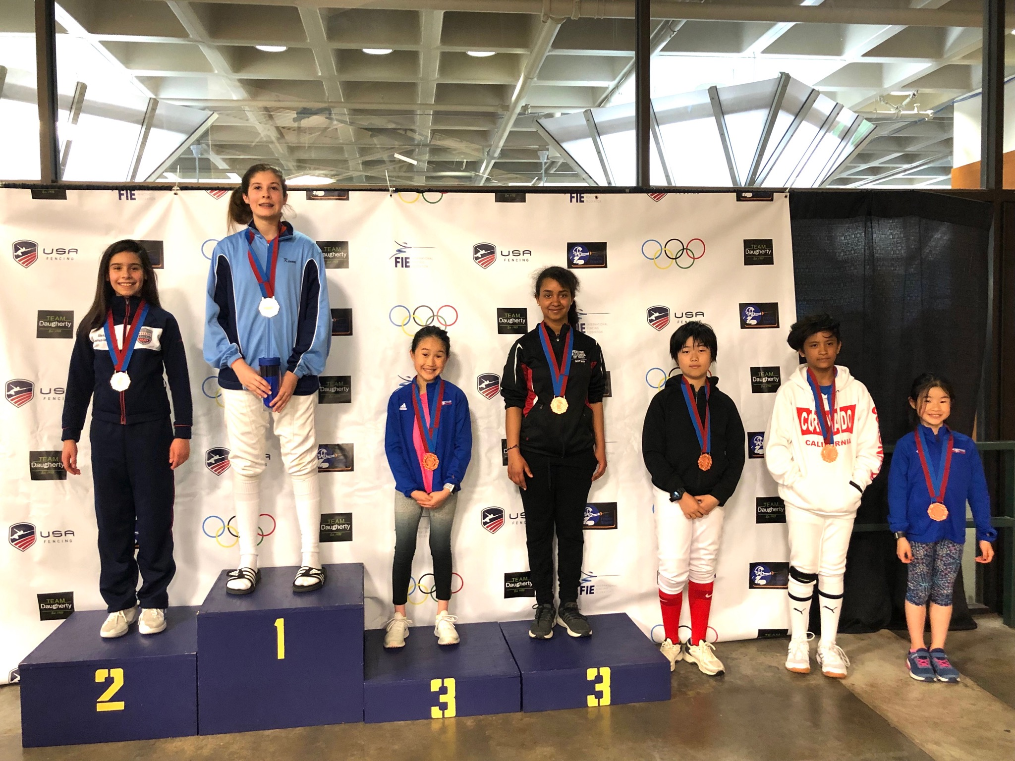 Pictured: Audrey Young wins a Bronze Medal and Charlotte Young wins a Top-8 Medal in Y-12 Women's Saber