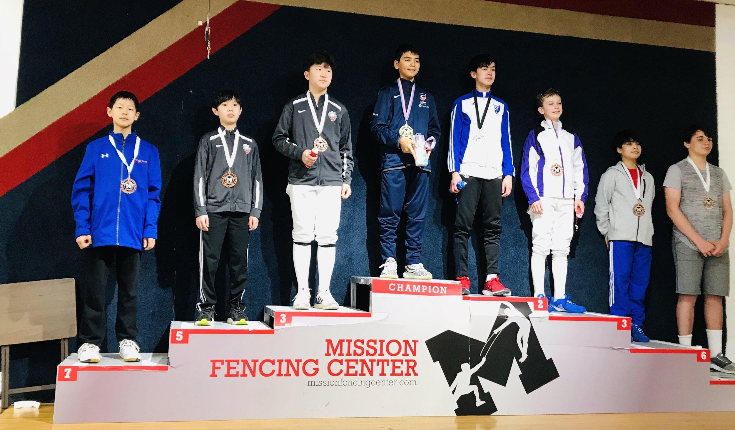 Pictured: Richard Li wins a Top-8 Medal in Y-14 Men's Foil