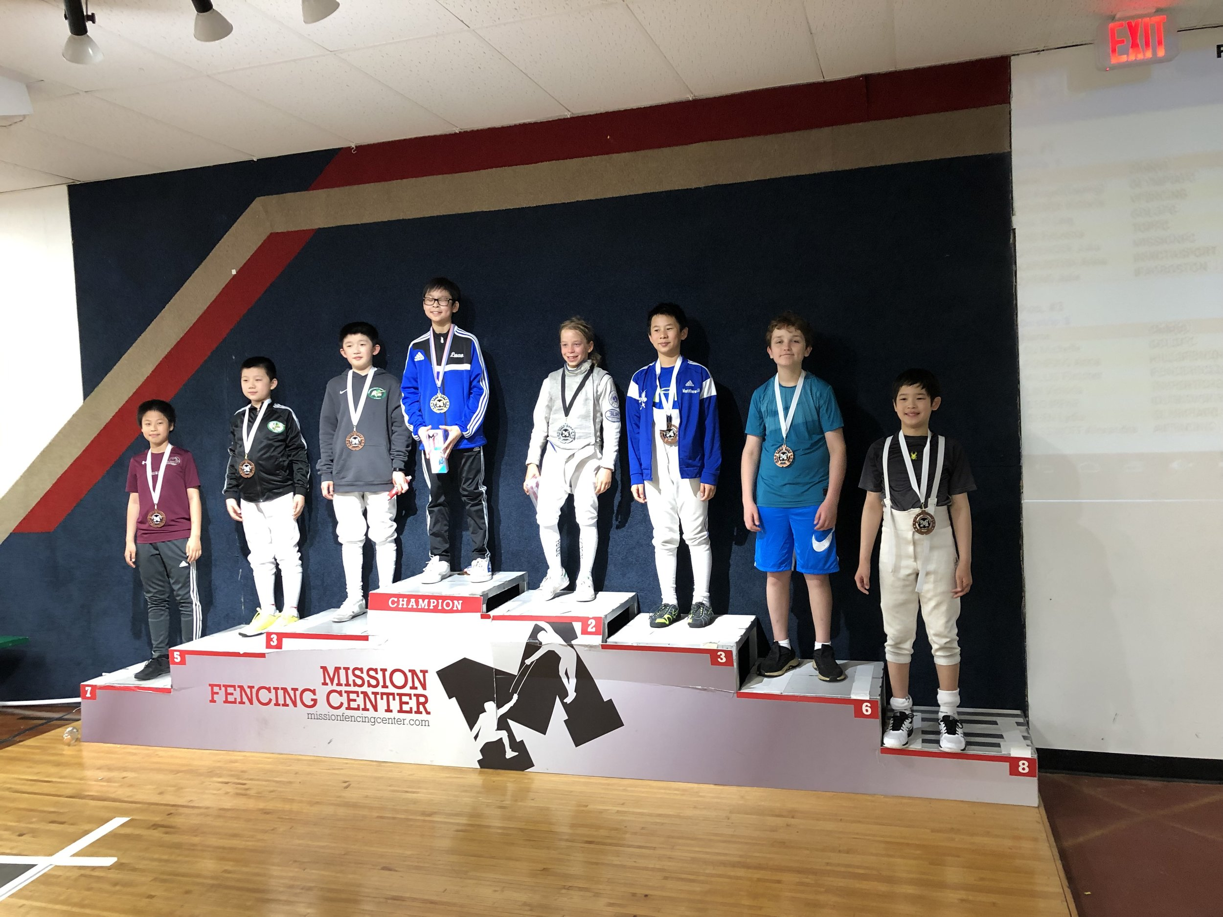 Pictured: Dylan Arouh wins a Top-8 Medal in Y-10 Men's Foil