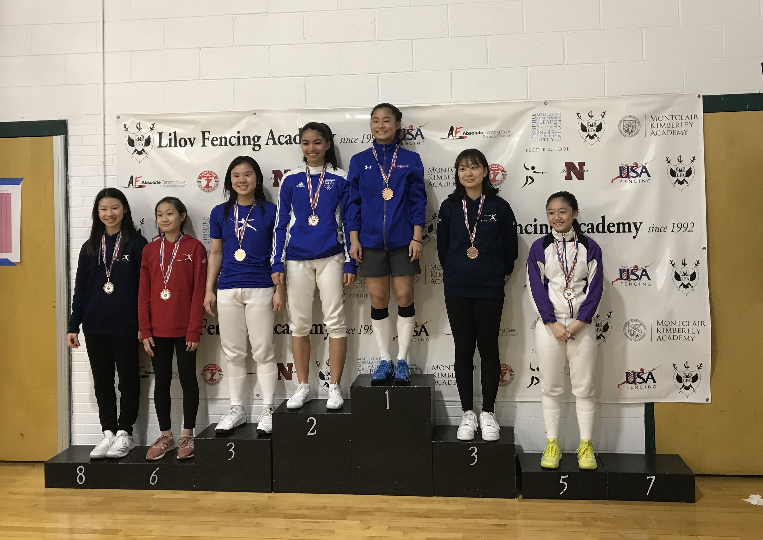 Pictured: Sabrina Fang wins a Gold Medal, and Bethany Lee wins a Bronze Medal in Cadet Women's Foil