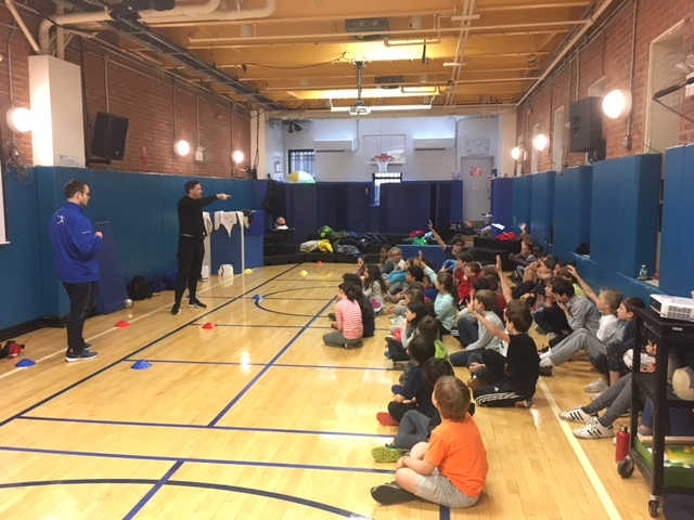 Pictured: Coach Lance and Coach Melvin give a fencing demo at the Metropolitan Montessori School