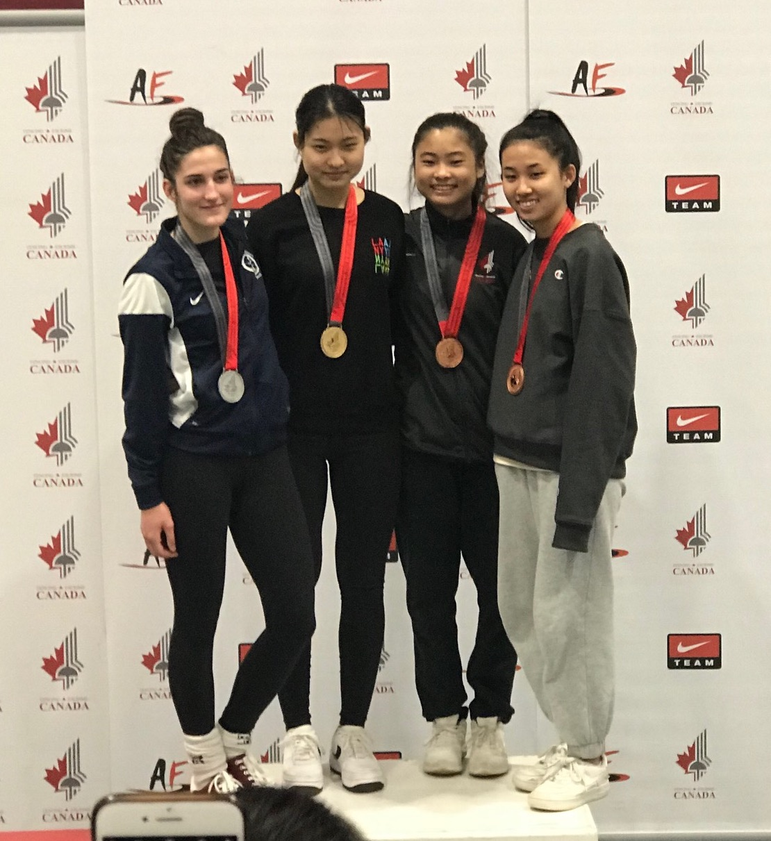 Pictured: Sabrina Fang receives her Bronze Medal in Senior Women's Foil