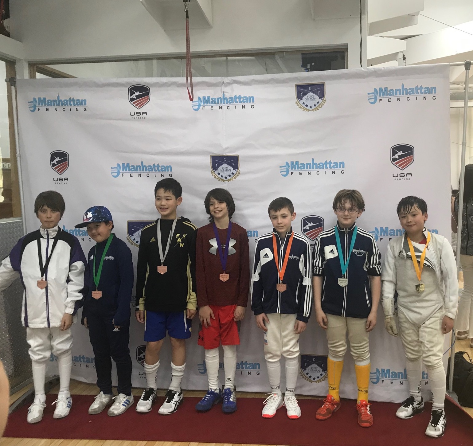 Pictured: Jackson Wong wins a Gold Medal in Y-10 Men's Foil