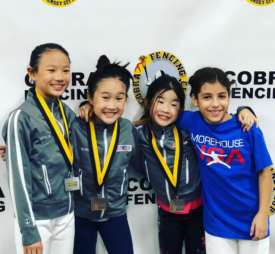 Regional Patch winners Catelyn So and Audrey Young at an SYC tournament in November 2018. Pictured left to right: Catelyn So, Audrey Young, Charlotte Young, Catalina Berrios