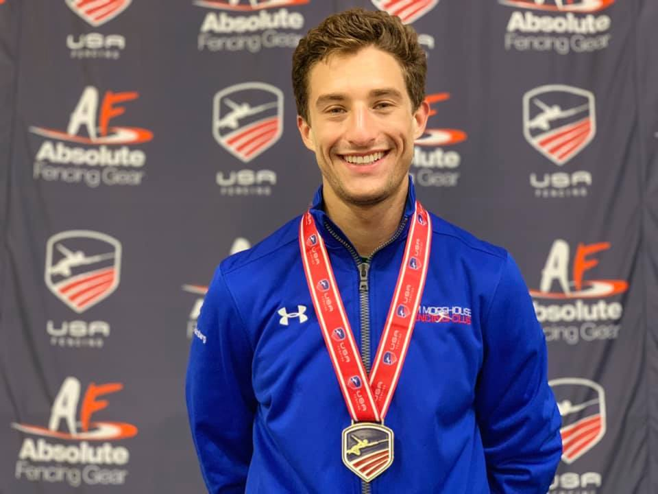 Pictured: Jonah Shainberg wins a Gold Medal in Div 1 Men's Saber