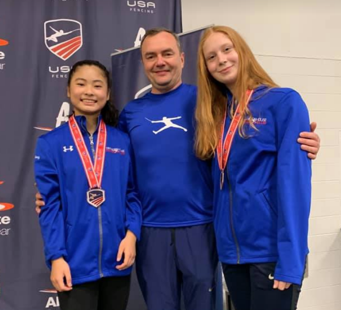 Bronze medalist Sabrina Fang and top-8 medalist Cat Flannagan with Coach Slava.