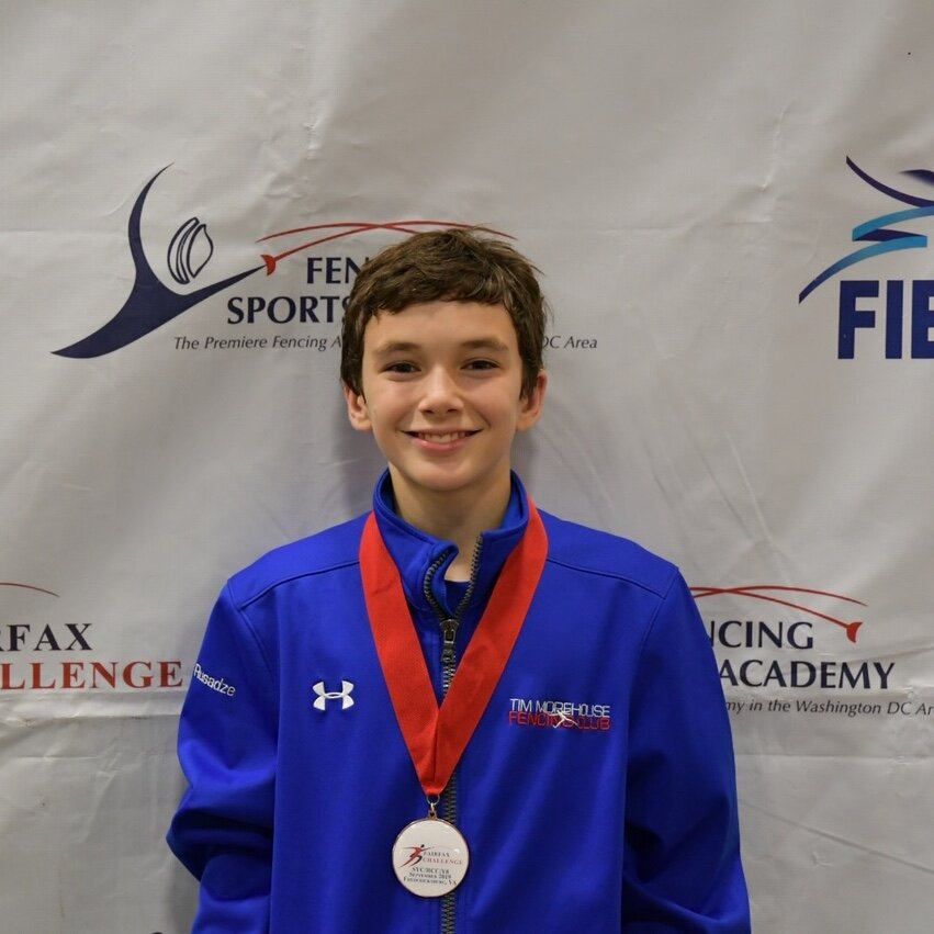Pictured: Nick Rusadze won a Bronze Medal in Y12 Men's Foil
