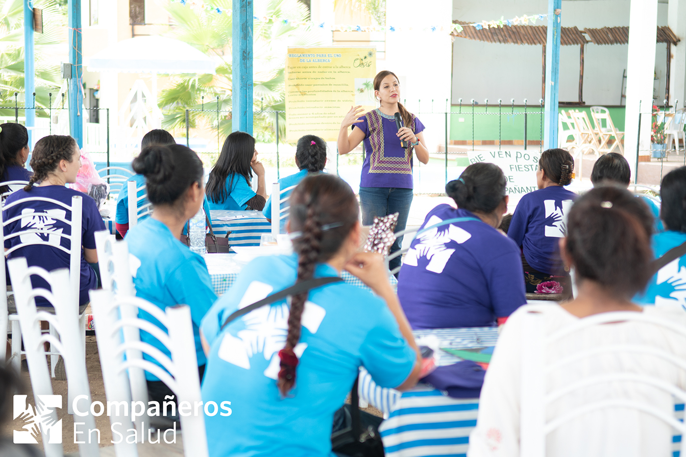 Photo: Dr. Jimena Maza, Director of Primary Care, addresses Compañeros En Salud's team of  Acompañantes  (community health workers) during a celebration in their honor.