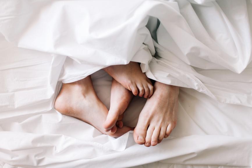 couple feet in bed.jpg