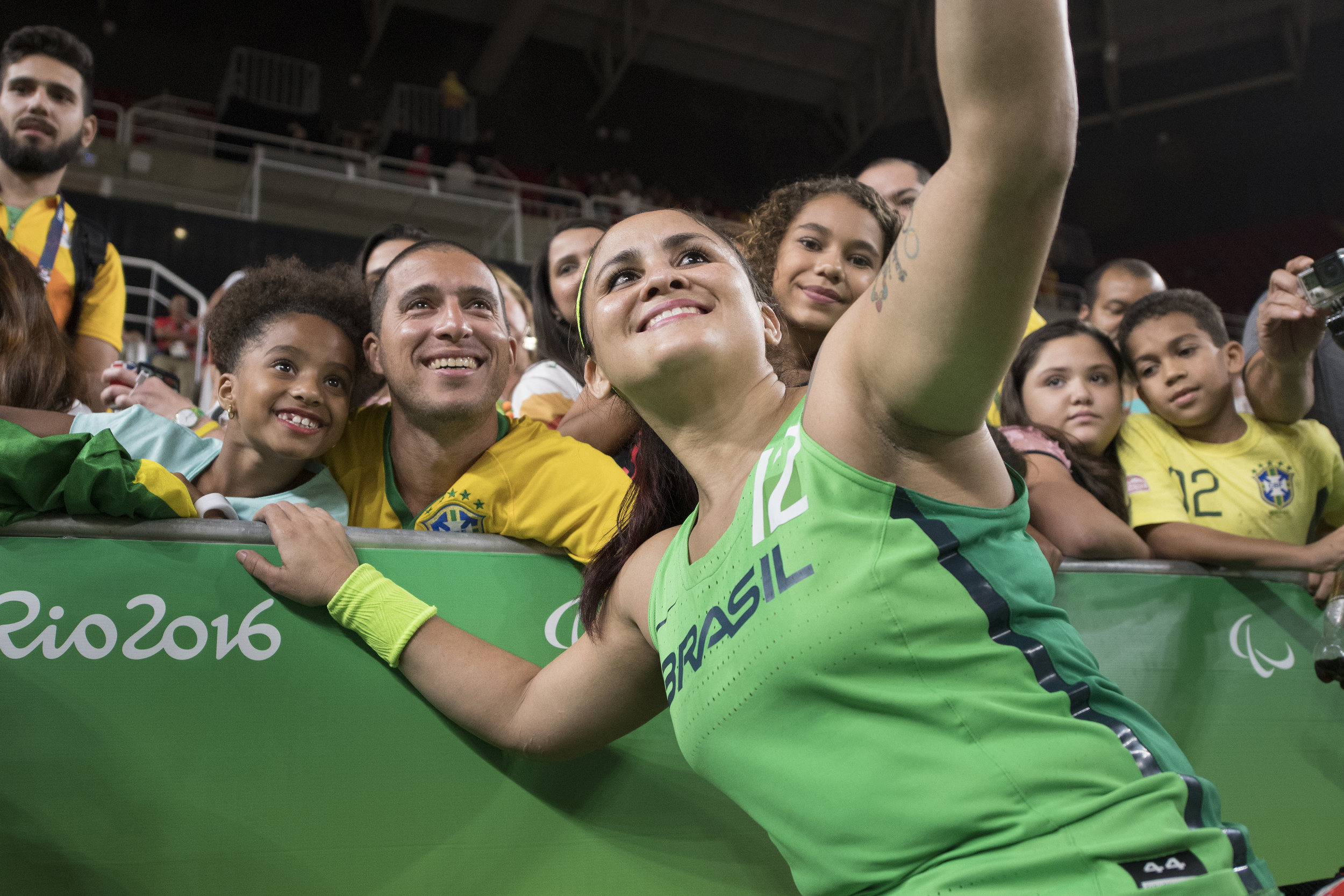 Brazil's Lia Martins takes a selfie with fans after Brazil's game against the U.S. in the women's wheelchair basketball quarter finals at the 2016 Paralympic Games in Rio de Janeiro, Brazil, on Tuesday, Sept. 13, 2016. The U.S. defeated Brazil 66-35.
