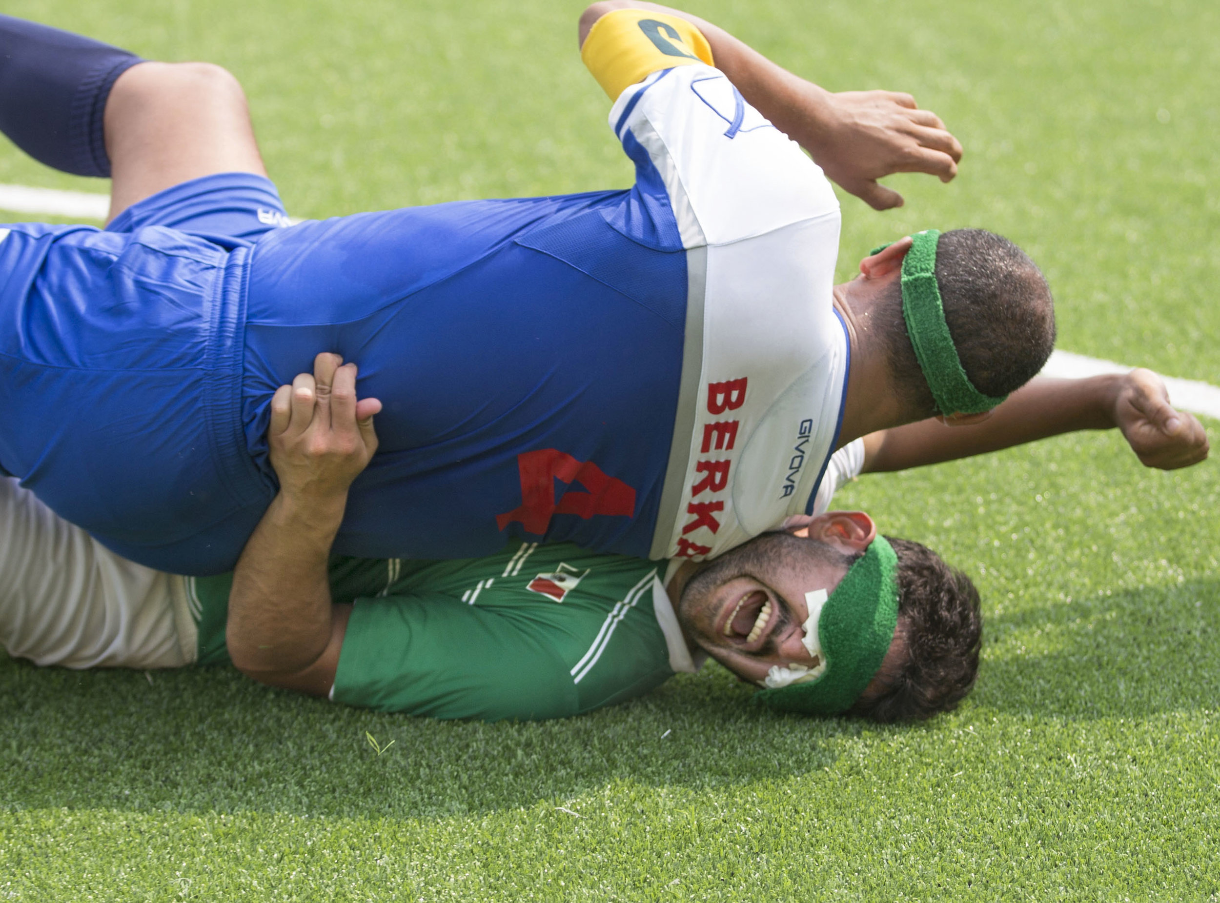 Mexican forward Jorge Lanzagorta gets flattened by Moroccan defender Imad Berka after the two collided while fighting for control of the ball in football five-a-side Thursday, Sept. 15, 2016, at the 2016 Paralympic Games. Mexico scored twice in the second half to win the game, 2-0.