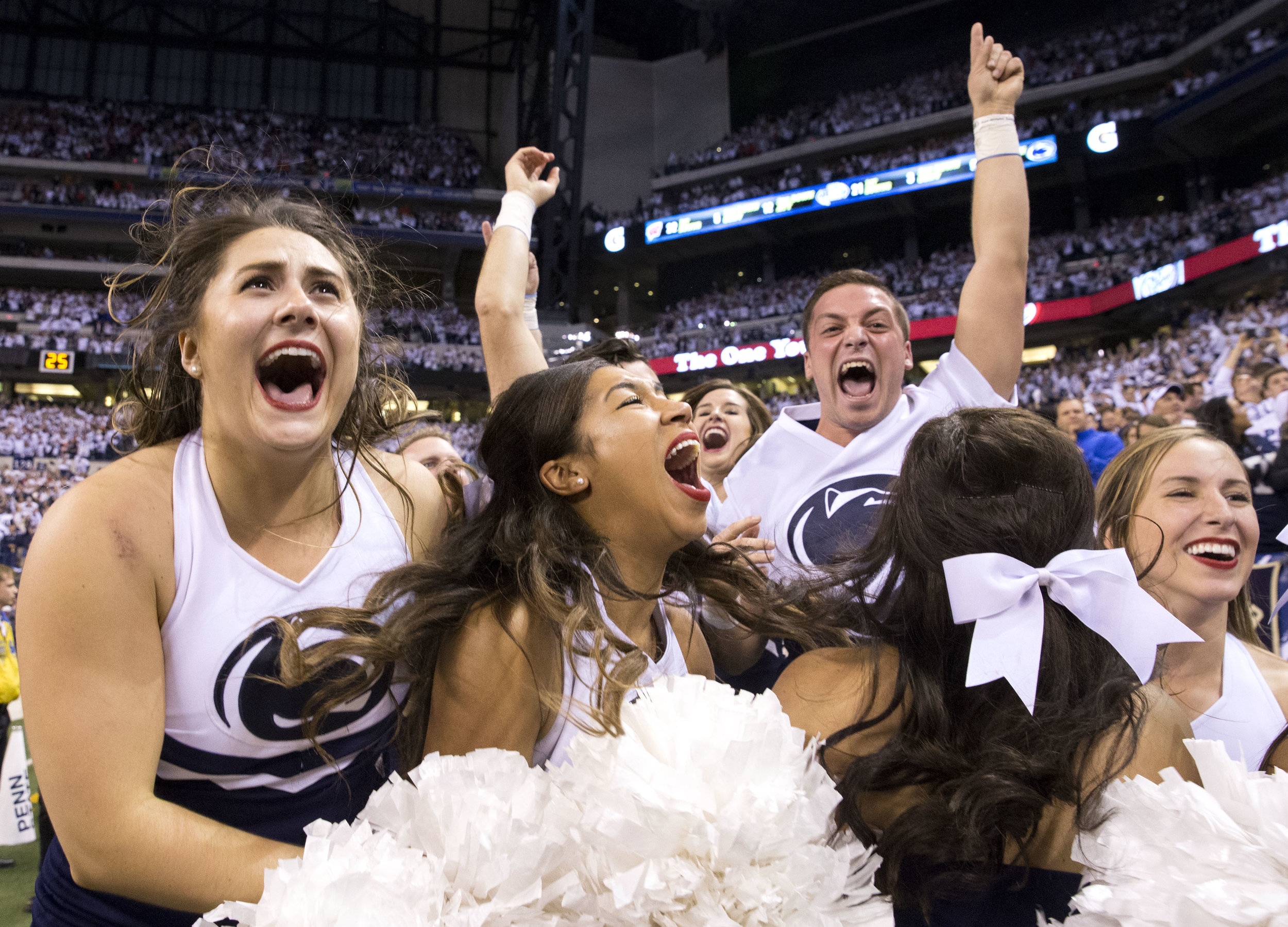Penn State cheerleaders react after seeing the final minutes in the fourth quarter and realizing that Penn State would be the Big Ten Champions during the Big Ten Football Championship Game between Penn State and Wisconsin at Lucas Oil Stadium in Indianapolis, Ind., on Saturday, Dec. 3, 2016. Penn State defeated Wisconsin 38-31.