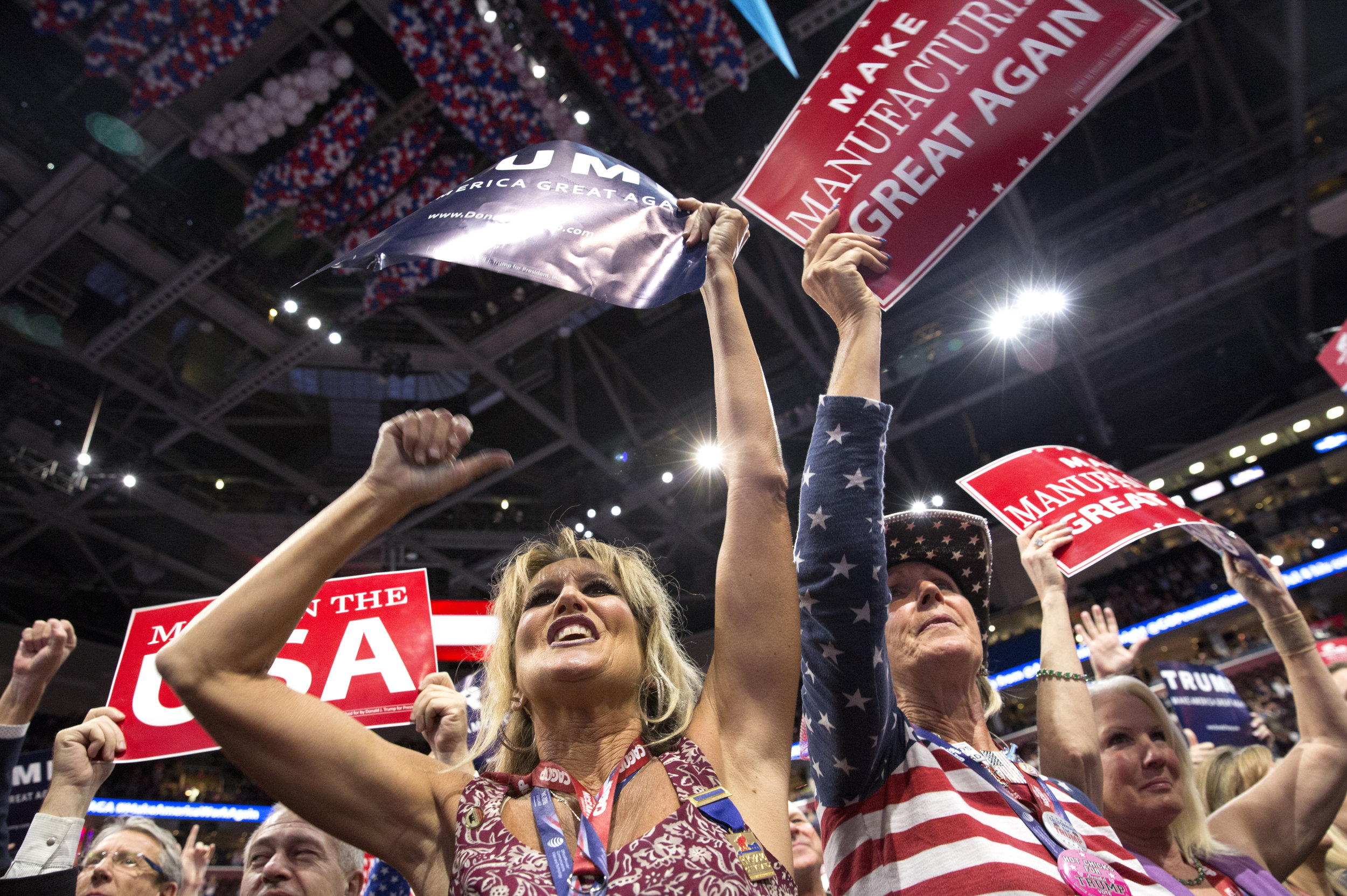 California delegates Kim Davis, left, and Elizabeth Ritchie, right, cheer after Chris Christie mentions Republican nominee Donald Trump on the second day of the Republican National Convention at the Quicken Loans Arena on Tuesday, July 19, 2016.