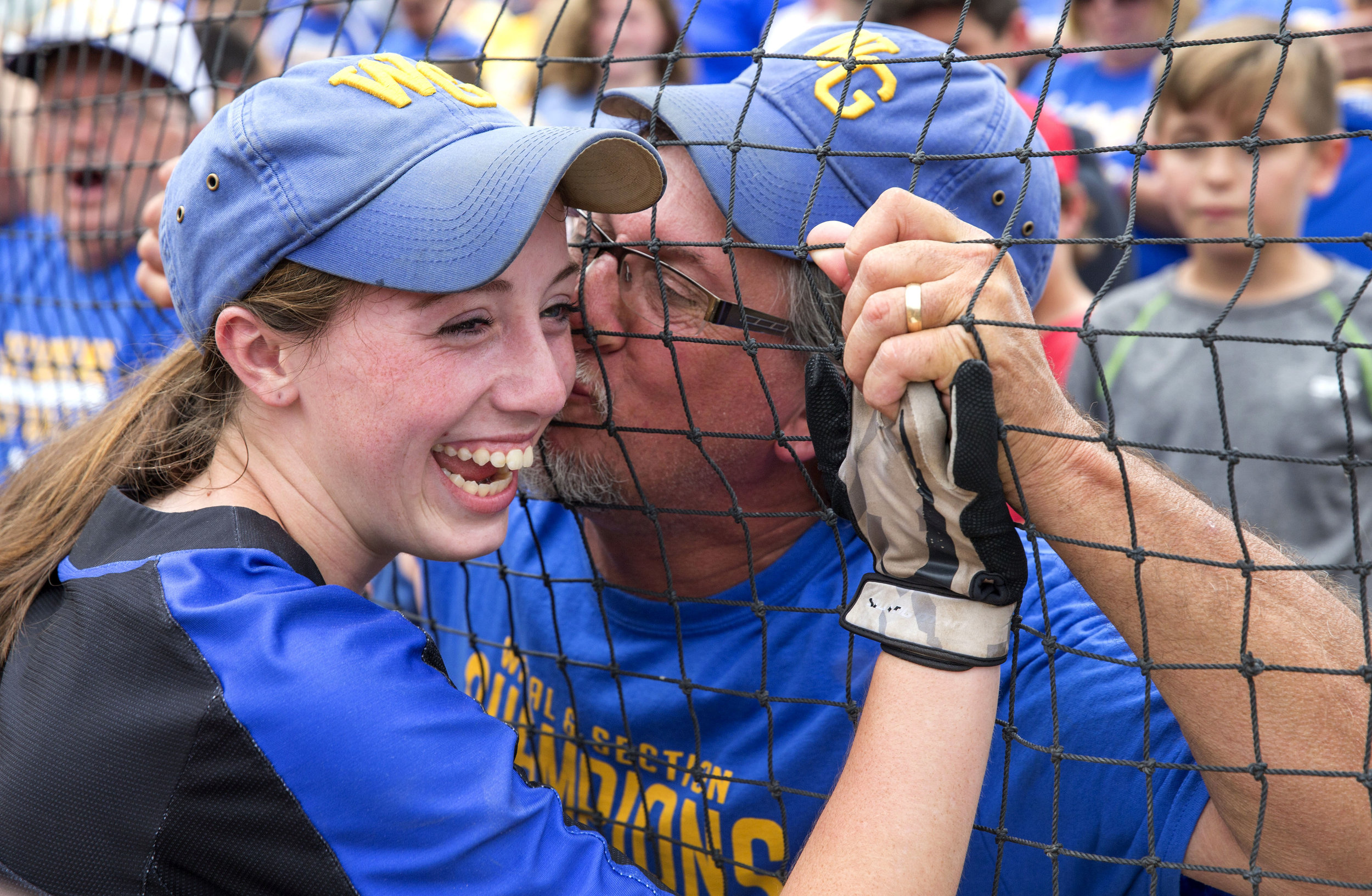 John Lampe, of West Greene, kisses his daughters cheek, Madison Lampe (4), after her team came back to win the state championship at Beard Field on Friday, June 16, 2017. West Greene was down 7-0 in the 2nd inning but rallied together to defeat Williams Valley 9-8.