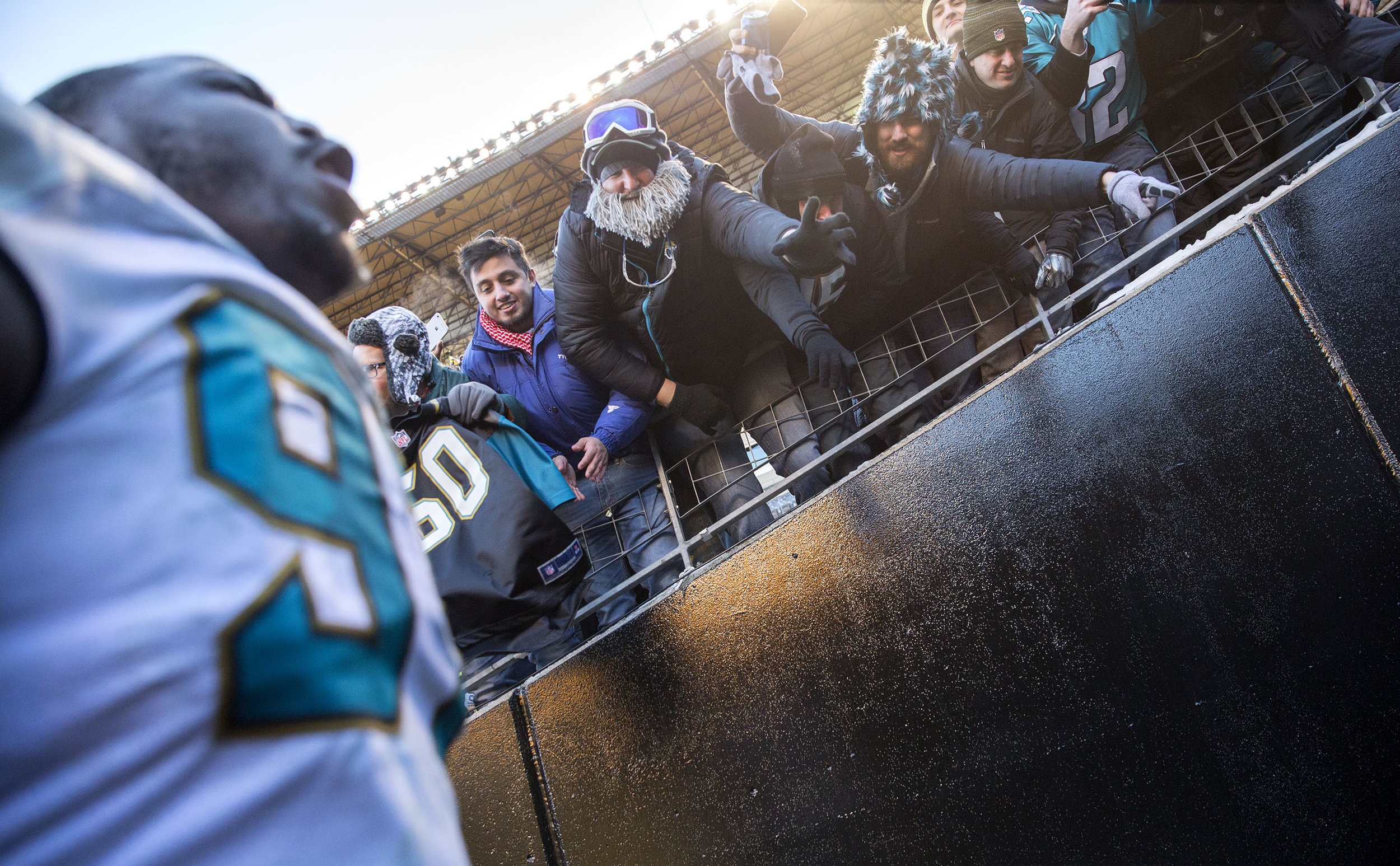 Fans wave at Jaguars Malik Johnson as he screams while entering the tunnel towards the locker room during the divisional playoff game on Sunday, Jan. 14, 2018 at Heinz Field. The Steelers lost to the Jaguars 45-42.