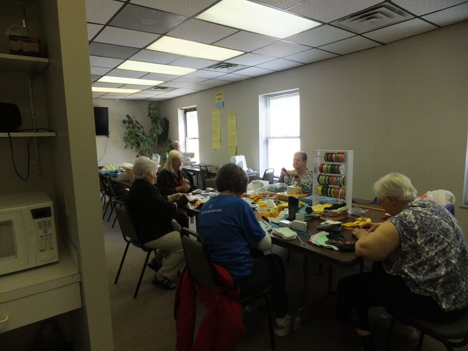 Messiah's Stitching Servants working on projects for missions.jpg