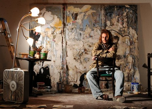 Joey Thate poses in front of one of his works in his new gallery and work space at the Jacksonville Landing, Thursday, January 28, 2010 in Jacksonville, FL. (The Florida Times-Union/Bruce Lipsky) 2009