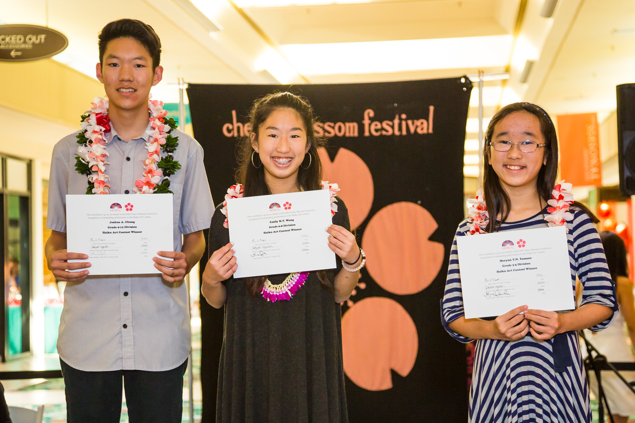 From left: Joshua Chung of Iolani School, Emily Wong of Iolani School, and Merynn Yamane of Kaneohe Elementary