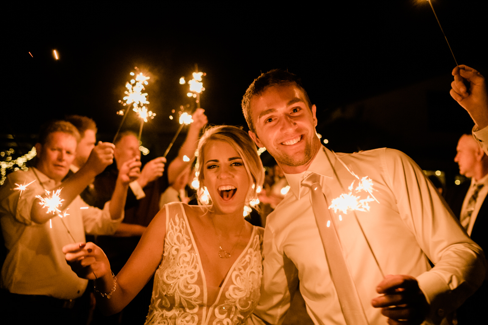 wedding-couple-exit-reception-with-fireworks-sparklers