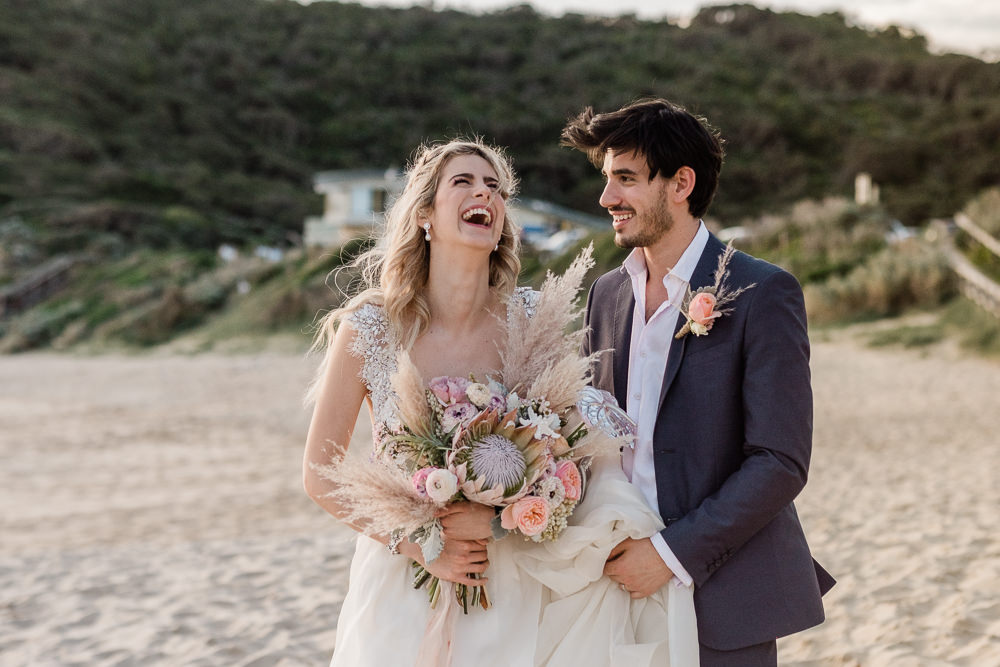 bride-and-groom-laughing-beach-wedding-photography
