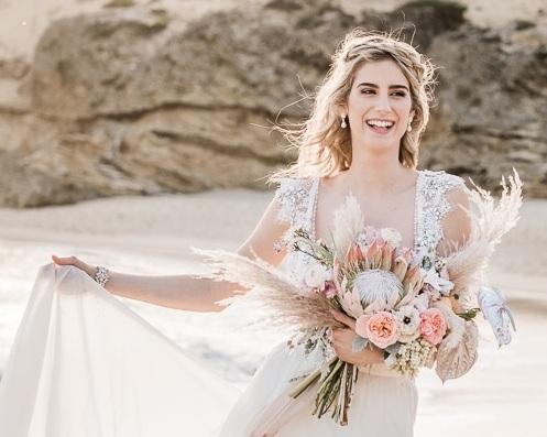 Bride-holding-flower-bouquet-wedding.jpg