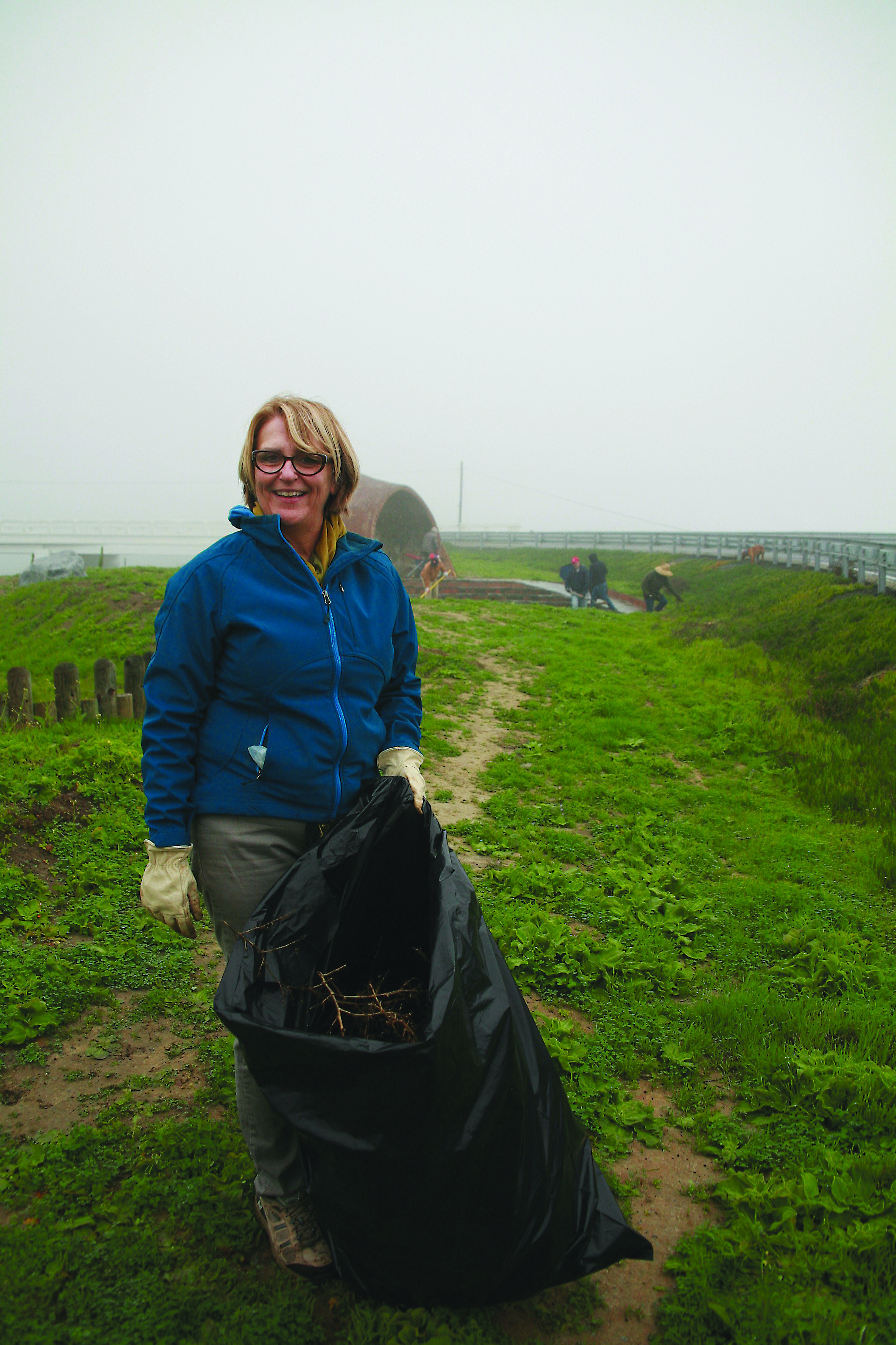 Marianne Gerdes, Ilan-Lael's Executive Director pitches in on the clean up!