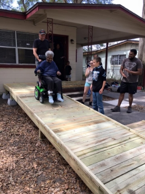 Dan helping Ms. Lilly down her new ramp