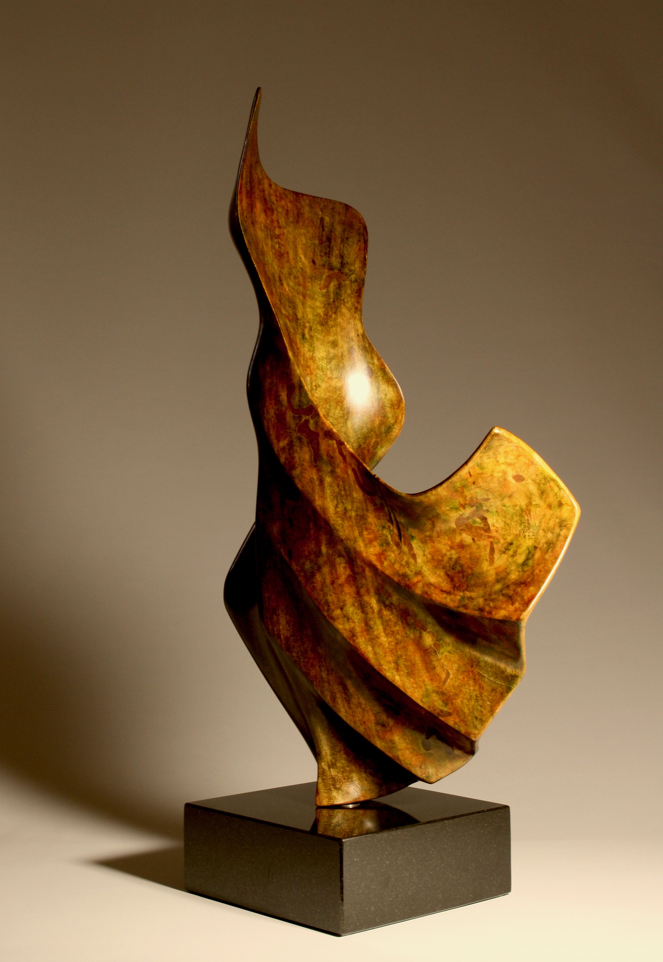 'Dancing in the Wind '- Sold    Wood:  colour dyed Mango   Dimensions:  69x36x20cm   Artist Statement:  This sculpture was inspired after seeing the film 'The Dancer' which I saw at the 2017 Brisbane French Film Festival.  It is based on a true story about Marie Louise Fuller, stage name Loie Fuller, who created a very moving and physically demanding dance for her large flowing silk costumes illuminated by multi-coloured lighting of her own design. She later became famous for her choreography.  2017 Highly Commended - Queensland Royal National Show