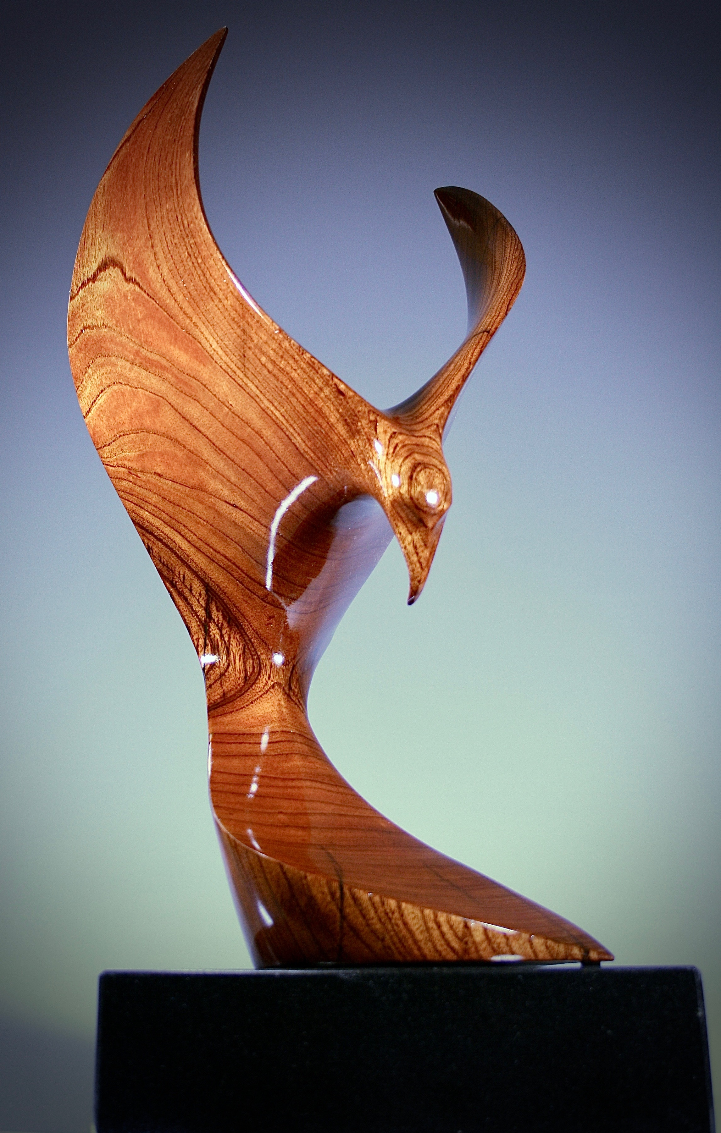 'Phoenix Rising' - Sold    Wood:  Cedar   Dimensions:  59x30x30cm   Artist Statement:  Associated with the Sun, a phoenix obtains new life by arising from the ashes of its predecessor.