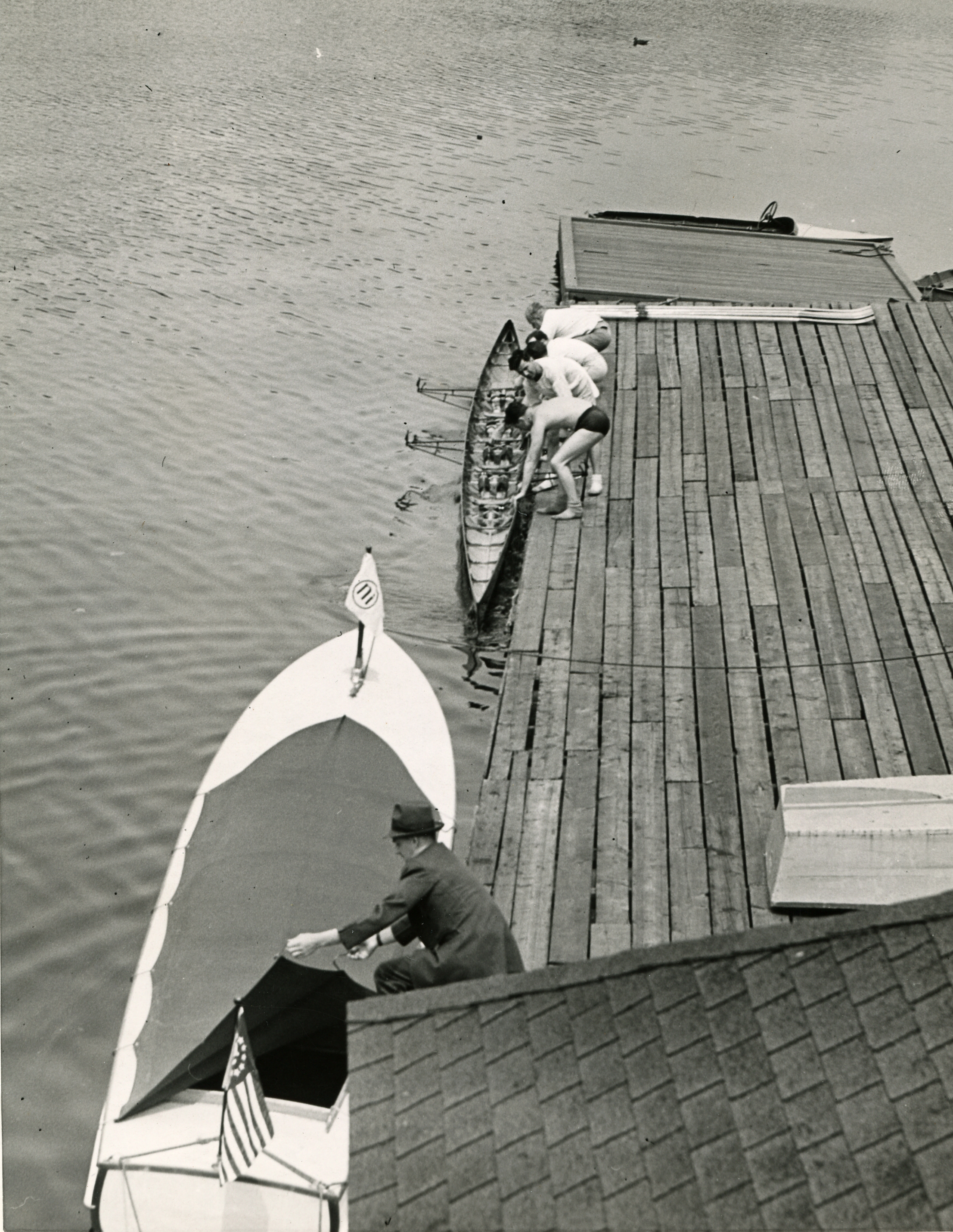 The White Swan and a rowing shell at the Company dock on the Charles River