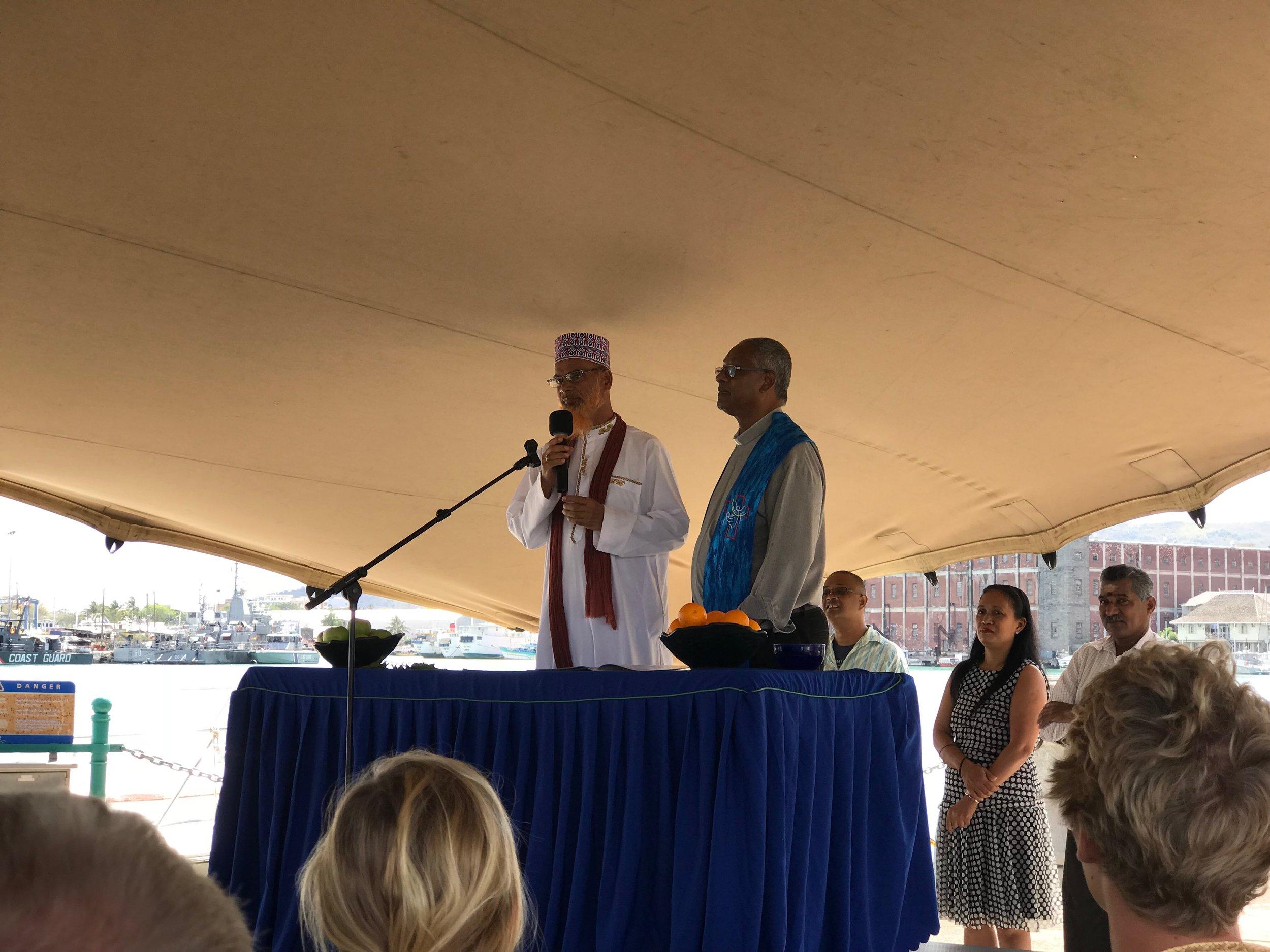 Imam and Priest blessing.JPG