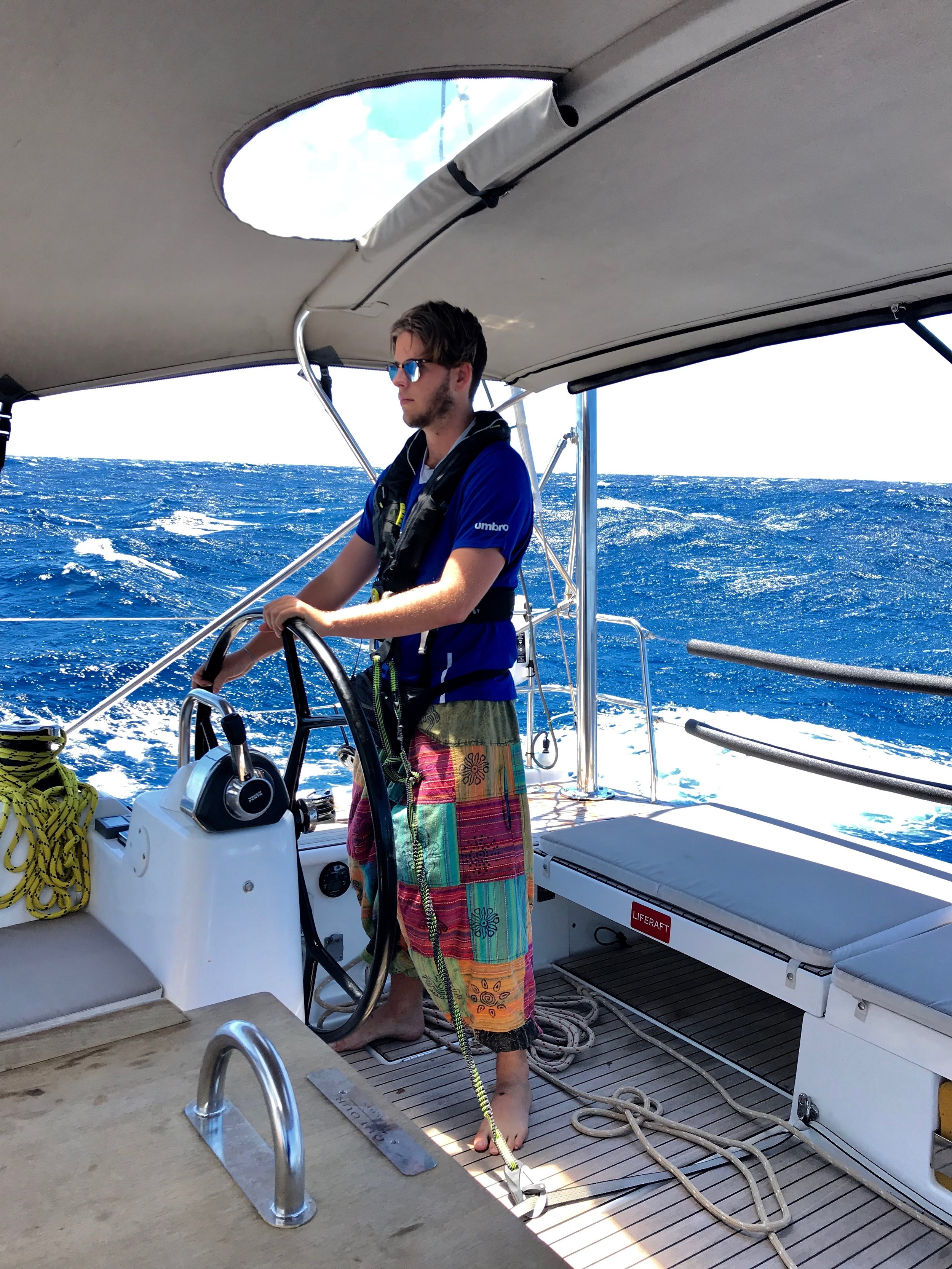 Josh gets his hippie on at the helm
