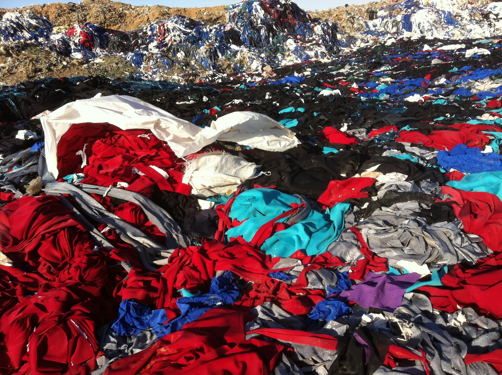 One of many landfill sites the outside world, where tons of fabric that could be used are trashed.