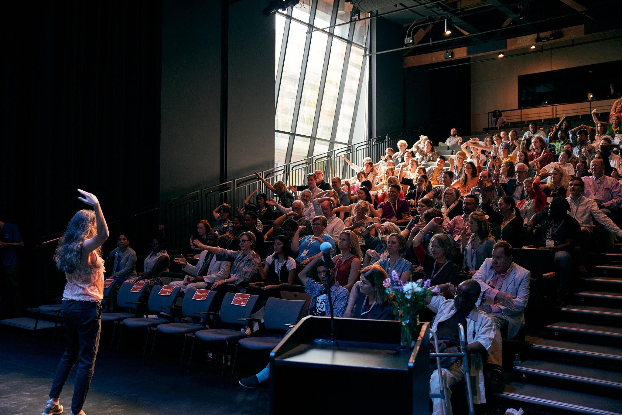 Christina Soriano delivering  pecha kucha  address at ARTIVATE: Creative Catalyst Summit (August 2019)
