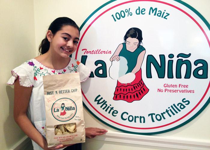 """""""LA NINA"""" posing with the logo."""