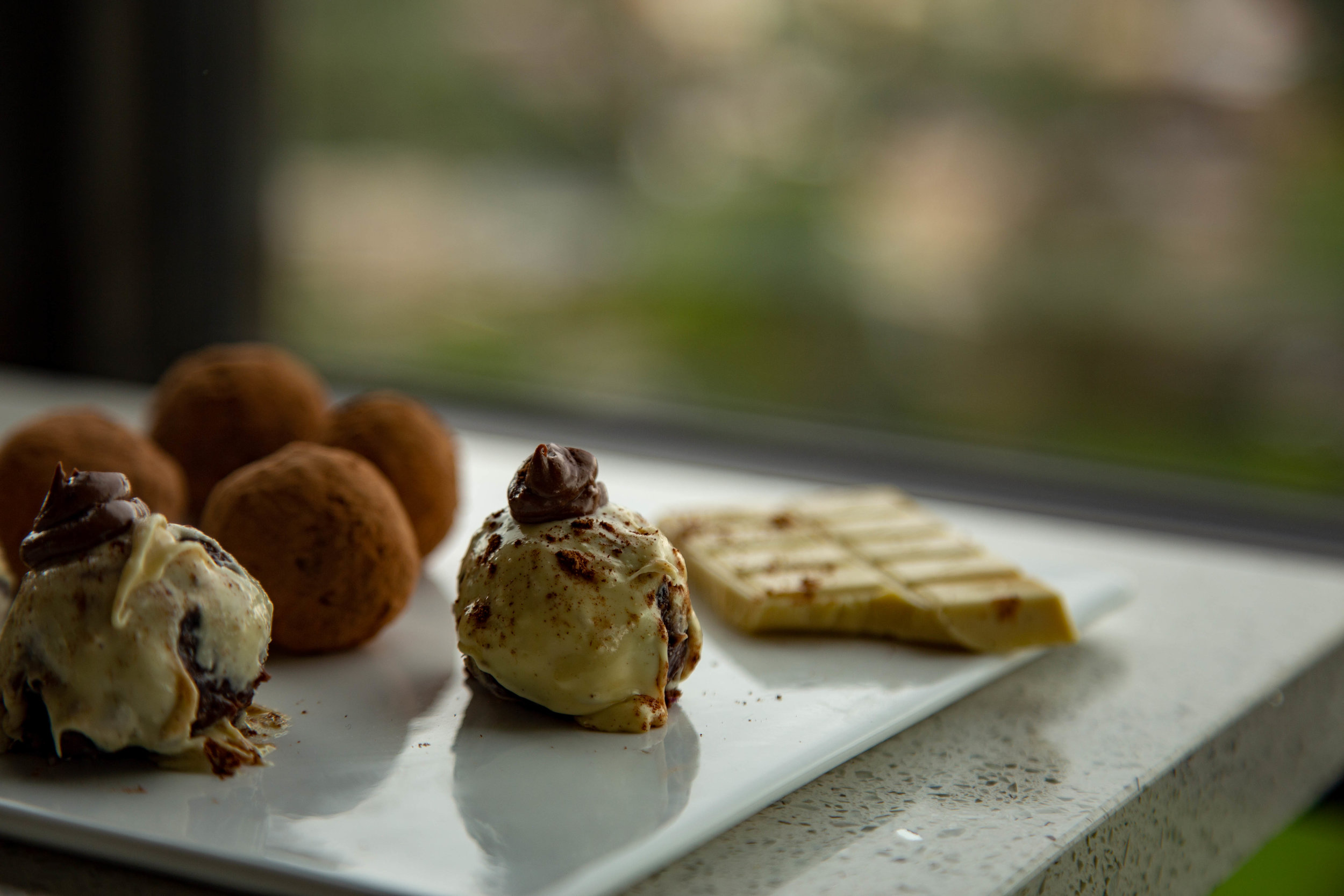 white chocolate potato truffles + cacao maca powder chocolate potato truffles