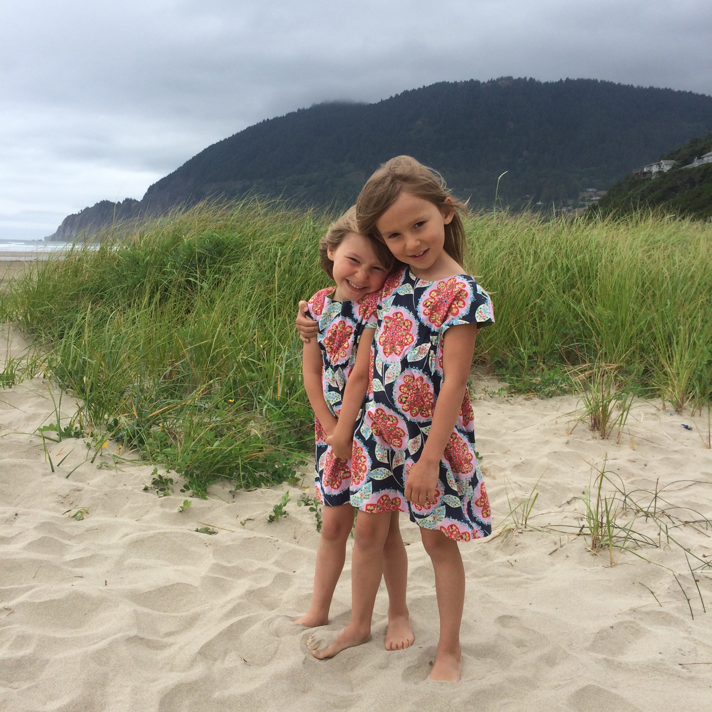nora and etta on the oregon coast in their  beatles rollerskate dresses