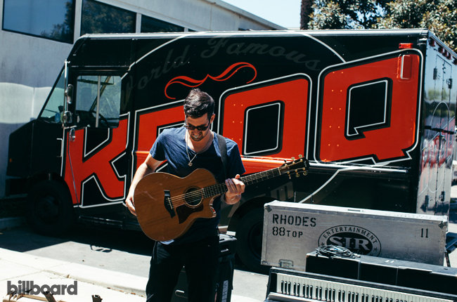 Noah Feldshuh straps on his guitar at KROQ, where they performed an acoustic set on Aug. 4, 2015.