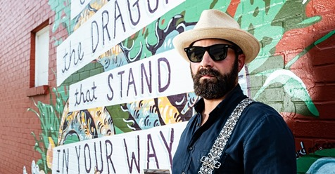 """THEEASTNASHVILLIAN.COM  DREW HOLCOMB  """"I'm feeling as good as I've ever felt about new music,"""" singer-songwriter Drew Holcomb says. He's sitting at a coffee shop on Dickerson Pike, reflecting on his time making the new Drew Holcomb and the Neighbors album,  Dragons . It's a couple weeks before the album's release in mid-August via Thirty Tigers."""
