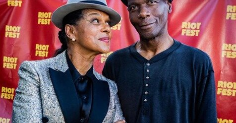 FORBES.COM   Pauline Black and Arthur Hendrickson of the Selecter backstage at Riot Fest 2019  ( Photo by Philamonjaro Studio)
