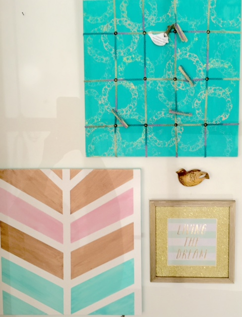 A sneak peak of the wall of artwork. Hand painted memory boards and canvases, as well as, art prints in up cycled frames.Please ignore my reflection in the canvas. That's quite embarrasing.
