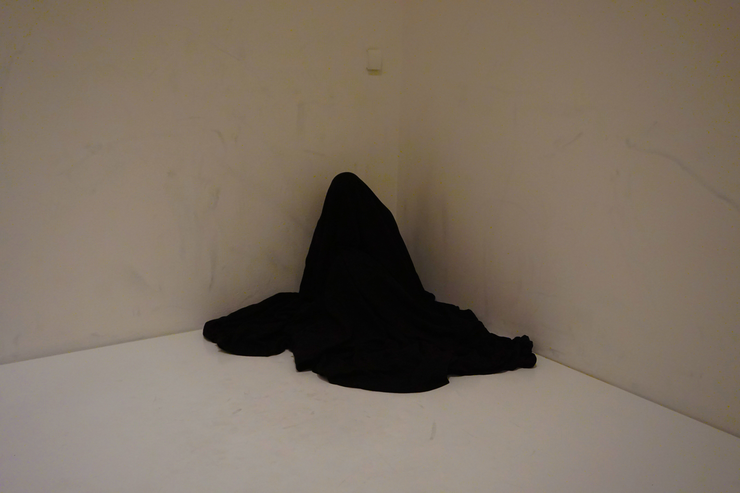 """""""Bag Piece,"""" by Yoko Ono, which was open to visitors to perform, a black bag in the middle of a white room...it was very odd (this guy was in there for at least 45 minutes), but I suppose it served its purpose as art, because I and a bunch of other people couldn't stop watching."""