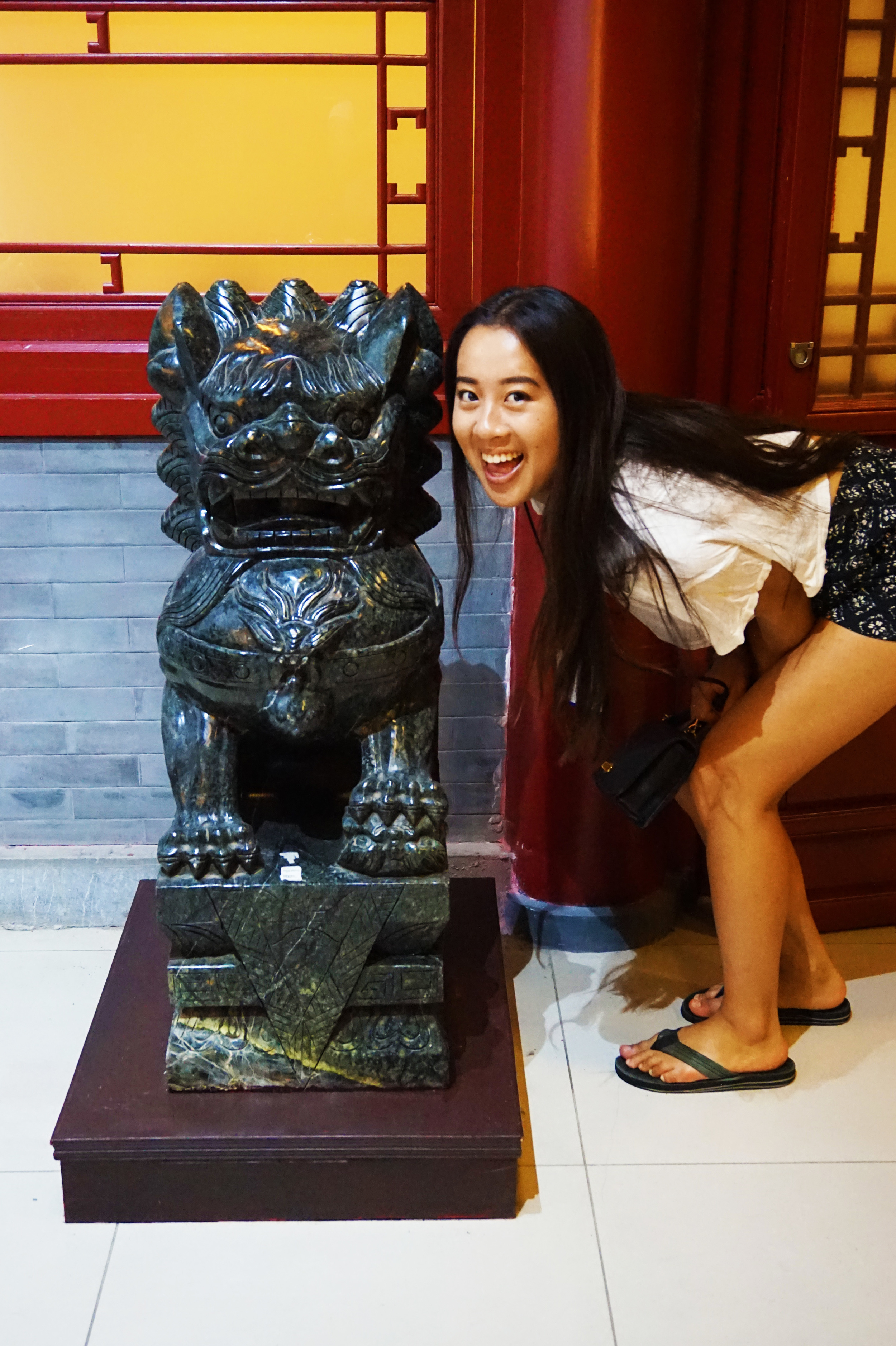 Sorority squatting with the jade lion