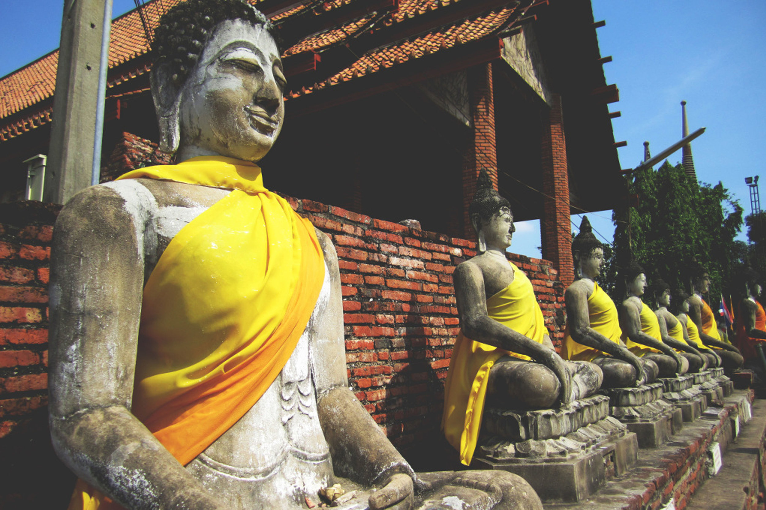 Row of stone buddhas at a temple in Thailand