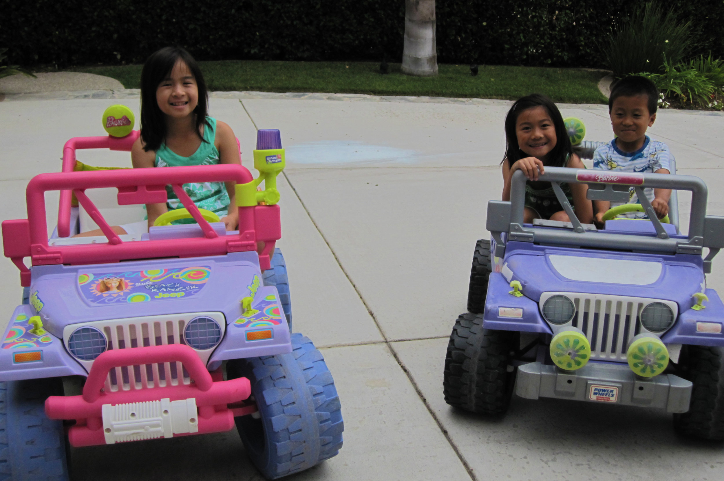 Kate, Caroline, and Alex in the Barbie Jeeps, c.2010