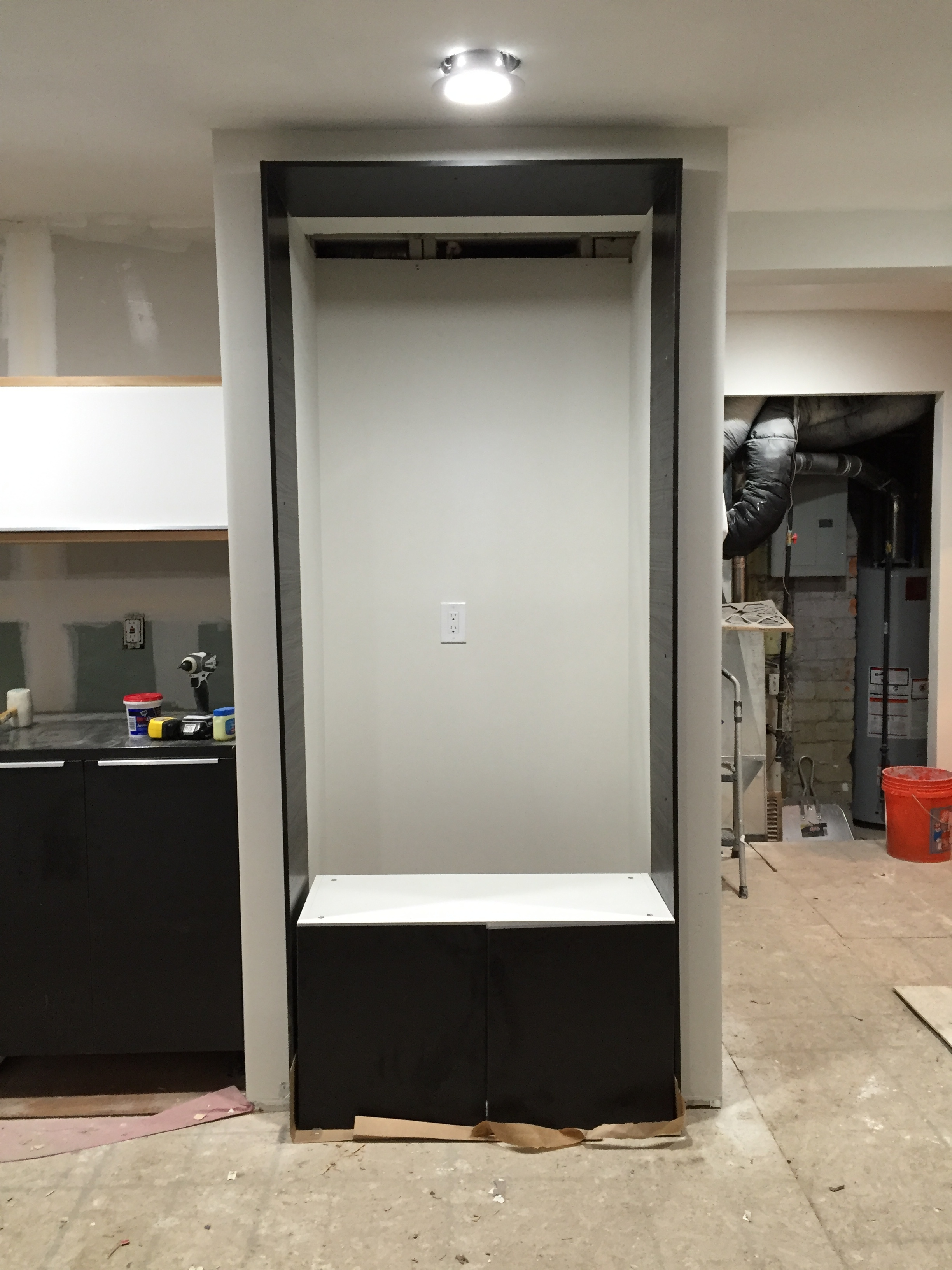 That cabinet on the floor will be above the refrigerator